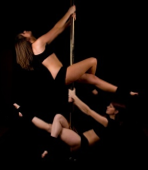 2 girls pole dancing